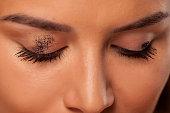 Mascara smudged on the eyelid. Make up concept