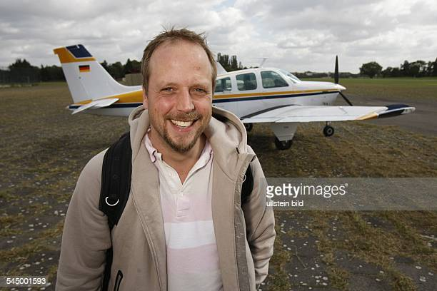 Smudo Musician Singer HipHop Germany at Tempelhof airport Berlin Germany in front of his plane