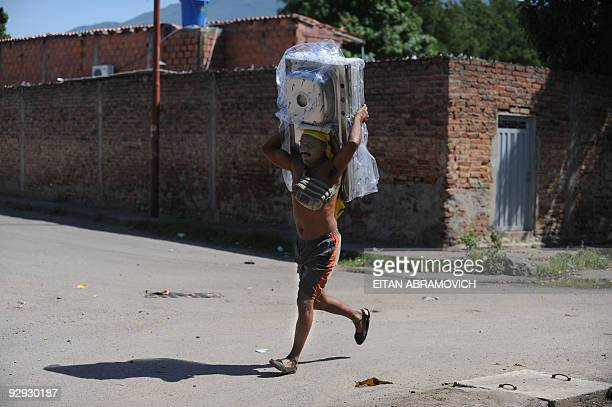 A smuggler carries a washbowl close to the Tachira river that connects Venezuela with Colombia in San Antonio Venezuela on November 9 2009 Venezuelan...