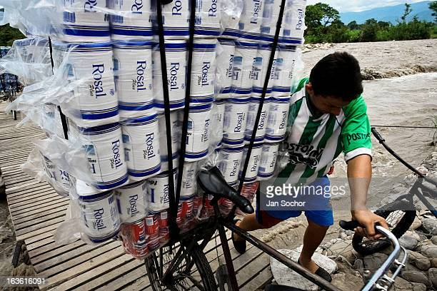 A smuggler pushes a bicycle loaded with contraband on the foot bridge across the river Tachira on the ColombiaVenezuela border on 2 May 2006 in La...