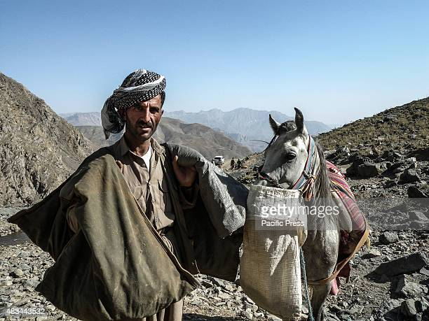 A smuggler with his horse The PDKI movement is in Iranian borders one kilometer away from the Iranian troops and where the Peshmerga stays