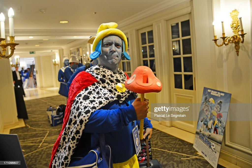 A Smurf Ambassador dressed up as a Smurf character poses during a ceremony as part of Global Smurfs Day celebrations on June 22, 2013 in Brussels, Belgium.