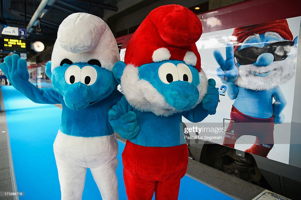 Smurf characters pose as Smurf Ambassadors prepare to board a branded high speed train from Brussels to Paris as part of Global Smurfs Day celebrations on June 22, 2013 at Brussels railway station, Belgium.