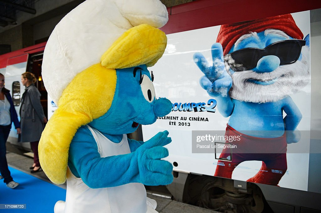 A Smurf characters stands by the train as Smurf Ambassadors prepare to board a branded high speed train from Brussels to Paris as part of Global Smurfs Day celebrations on June 22, 2013 at Brussels railway station, Belgium.