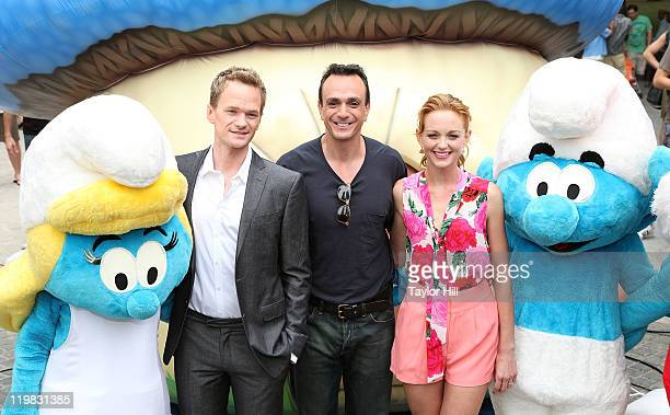 Smurfette Neil Patrick Harris Hank Azaria Jayma Mays and a smurf attend the New York Smurf Week kick off ceremony at Smurfs Village at Merchant's...