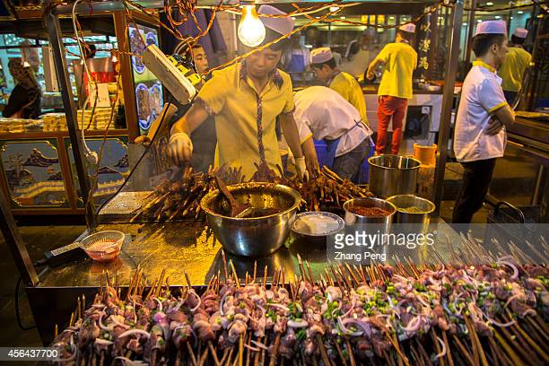 XI'AN SHAANXI CHINA Snack stalls of spicy kebabs in the Muslim Quarter in Xian located at the north of the Drum Tower is a famous tourist attraction...