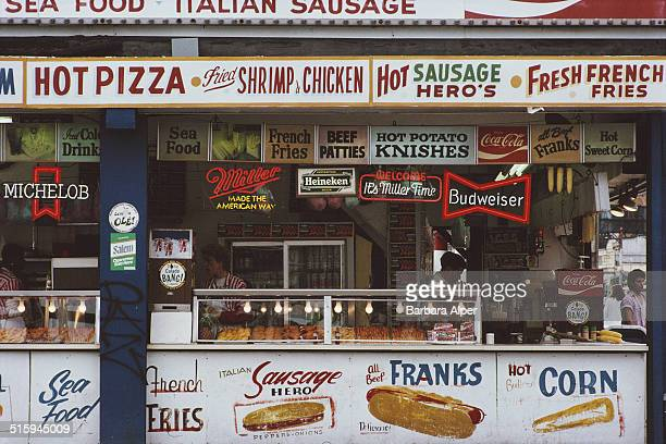 A snack stand in Coney Island New York City selling hot dogs and beer June 1987