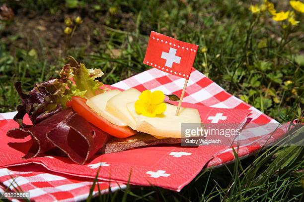 Bread and flower with Swiss flag on napkin, close-up