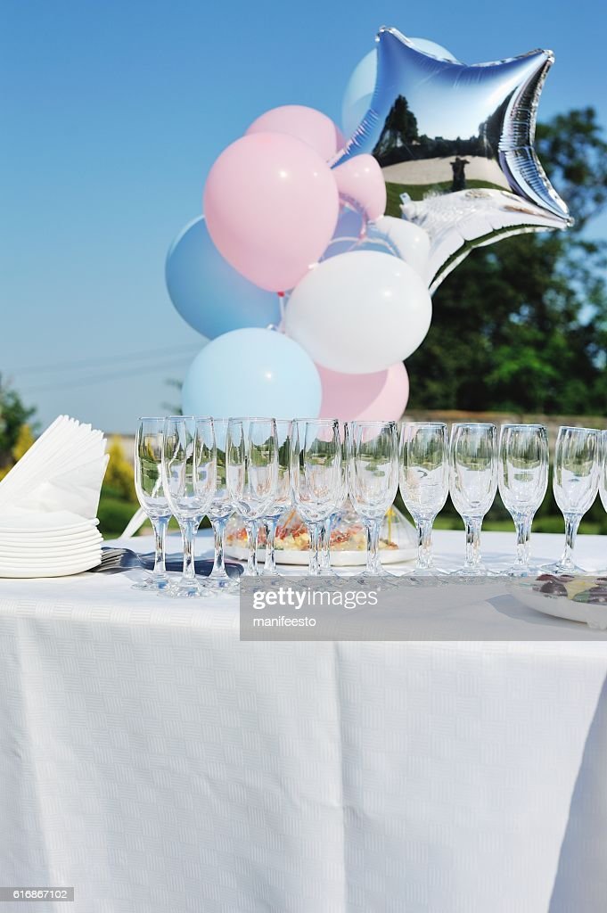 snacks and drinks on wedding table in garden : Stock Photo