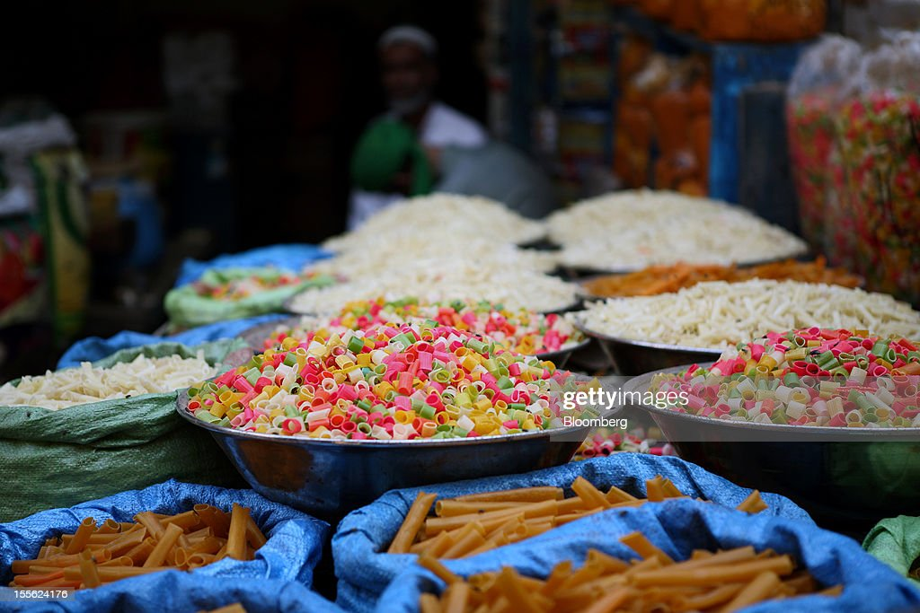 Snacks are displayed for sale at a stall in Jodia Bazar in Karachi, Pakistan, on Wednesday, Oct. 31, 2012. Businesses in Pakistan's commercial capital are bracing for a surge in extortion demands as parties representing the city's ethnic communities seek to use their hired guns to build financial war chests ahead of parliamentary polls due in the first half of next year. Photographer: Asim Hafeez/Bloomberg via Getty Images