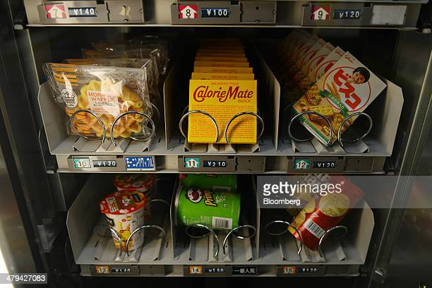 Snacks are displayed for sale in a vending machine in Tokyo Japan on Sunday March 16 2014 Japan's economy expanded less than estimated in the fourth...