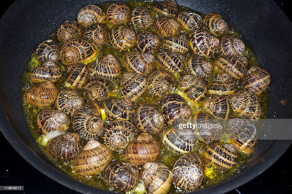 Snail fried in the pan on March 23, 2011 in Heraklion, Greece.