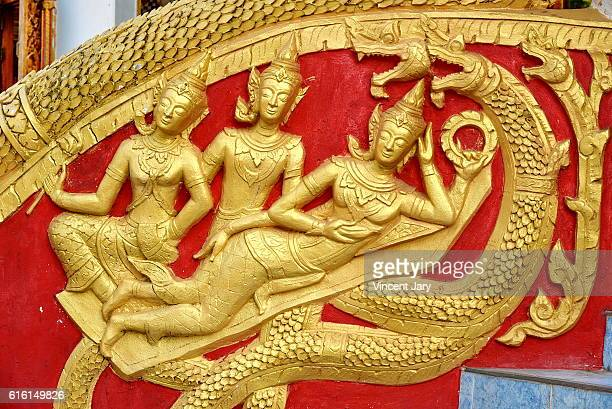 Snake carving on stairs laos