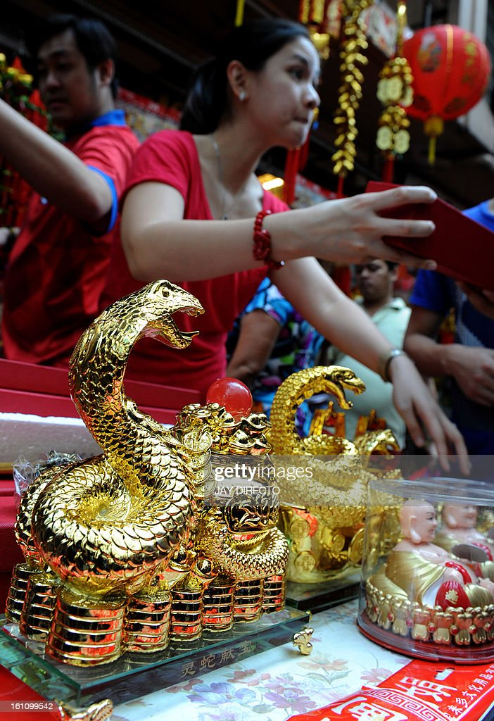 Snake ornaments on sale on the eve of the Chinese Lunar New Year of the Snake, in China town in Manila on February 9, 2013. The Dragon Dance is usually performed during the Chinese New Year to bring in good luck and prosperity as billions of Chinese world wide celebrate Lunar New Year of the Snake on February 10. AFP PHOTO / Jay DIRECTO