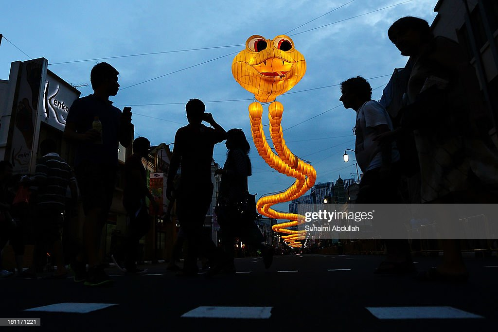 A snake shaped sculpture made from about 850 yellow sky lanterns looms over a road in Chinatown on February 9, 2013 in Singapore. Thousands gathered today to celebrate the Chinese New Year and welcome the the Year of the Snake, with new year's day falling on February 10. Chinese new Year is the most important festival in the Chinese calendar and is celebrated in Singapore and many other Southeast Asian countries with significant Chinese Populations.