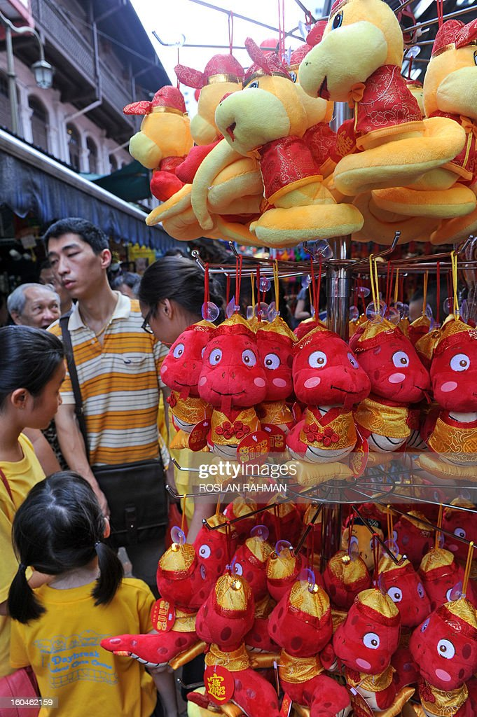 Snake themed stuffed toys are displayed at a street stall ahead of the upcoming Chinese lunar New Year of the snake in Chinatown of Singapore on February 1, 2013. Chinese celebrate the Chinese lunar New Year of the snake on February 10.