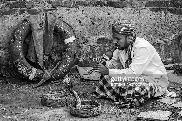 Snakecharmer in black and white