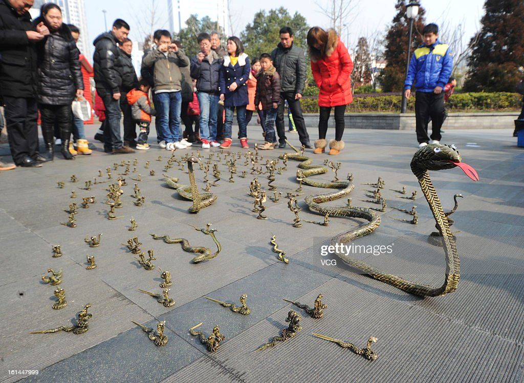 Snakes made of palm leaves are displayed to celebrate the Chinese Spring Festival at Greenland Square on February 10, 2013 in Shanghai, China. Chinese people around the world are ushering in the Year of the Snake with prayers, feasts and fireworks.