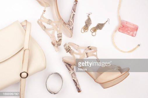 Snakeskin platform heels with earrings bracelet and bag