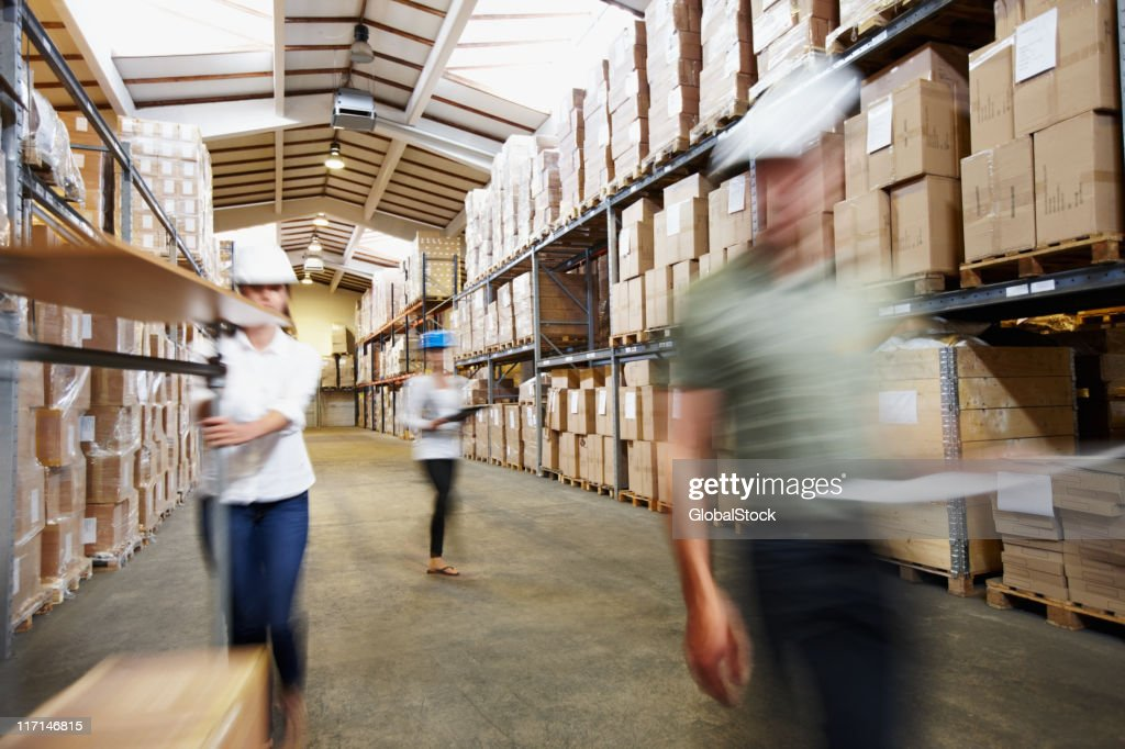 Workers at the wholesale and retail warehouse depot