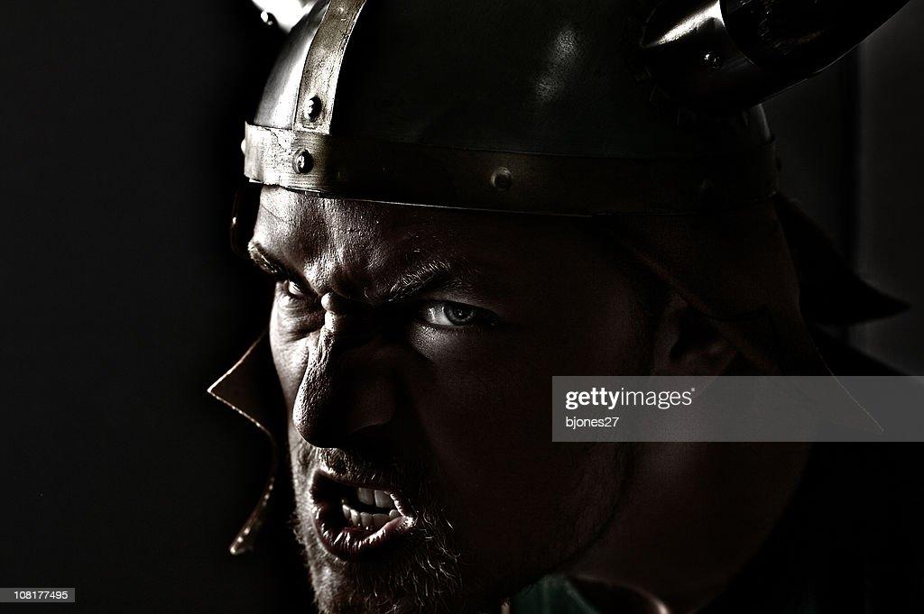 Snarling Man Wearing Viking Hat, Low Key