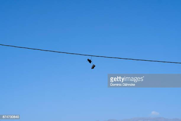 Sneakers hanging from a cable