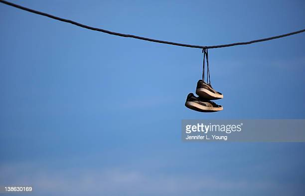 Hanging Pictures On Wire cable shoe hanging stock photos and pictures | getty images