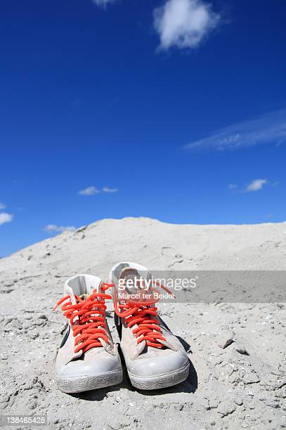 Sneakers in sand