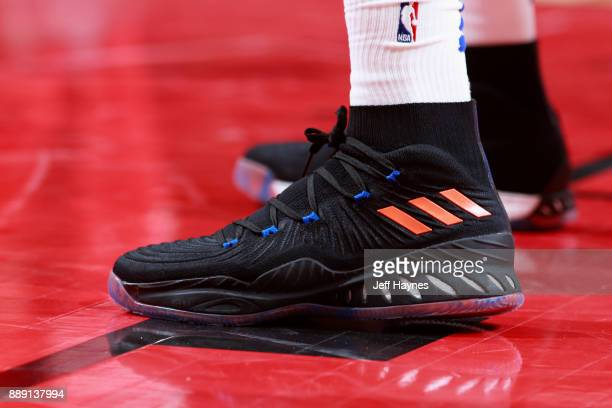 Sneakers of Kristaps Porzingis of the New York Knicks during the game against the Chicago Bulls on December 9 2017 at the United Center in Chicago...