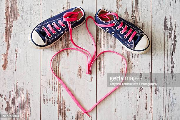 Sneakers, shoelases make the shape of heart