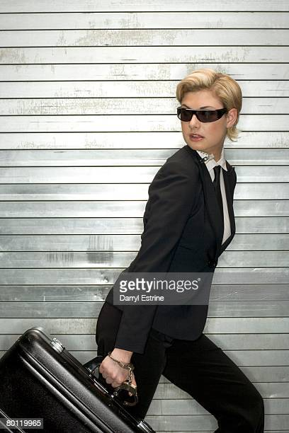 Sneaky businesswoman carrying briefcase