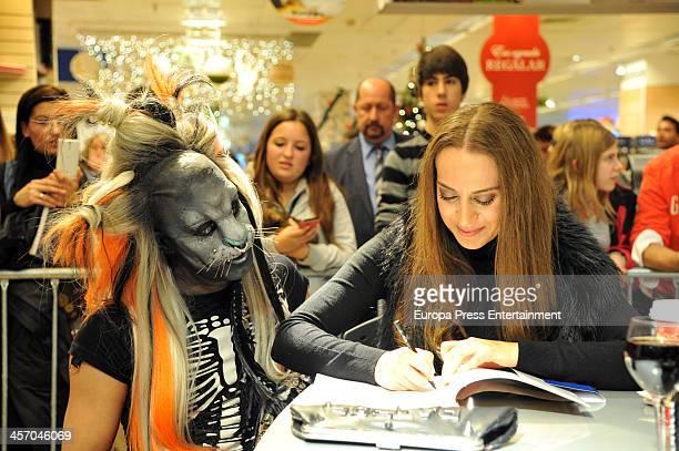 Snger Monica Naranjo signs copies of her book 'Come y calla' at El Corte Ingles Store on December 14 2013 in Barcelona Spain
