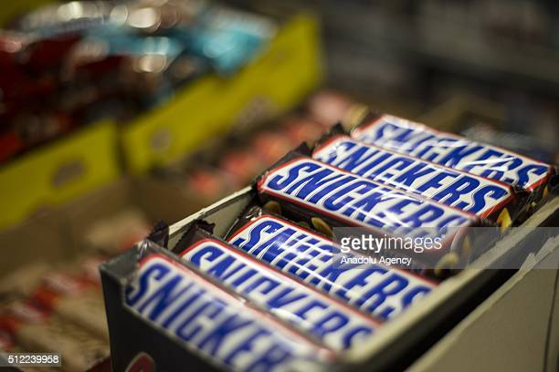 Snickers chocolate bars are seen at a market in Ankara Turkey on February 25 2016 American candy maker Mars announced Tuesday that it was recalling...