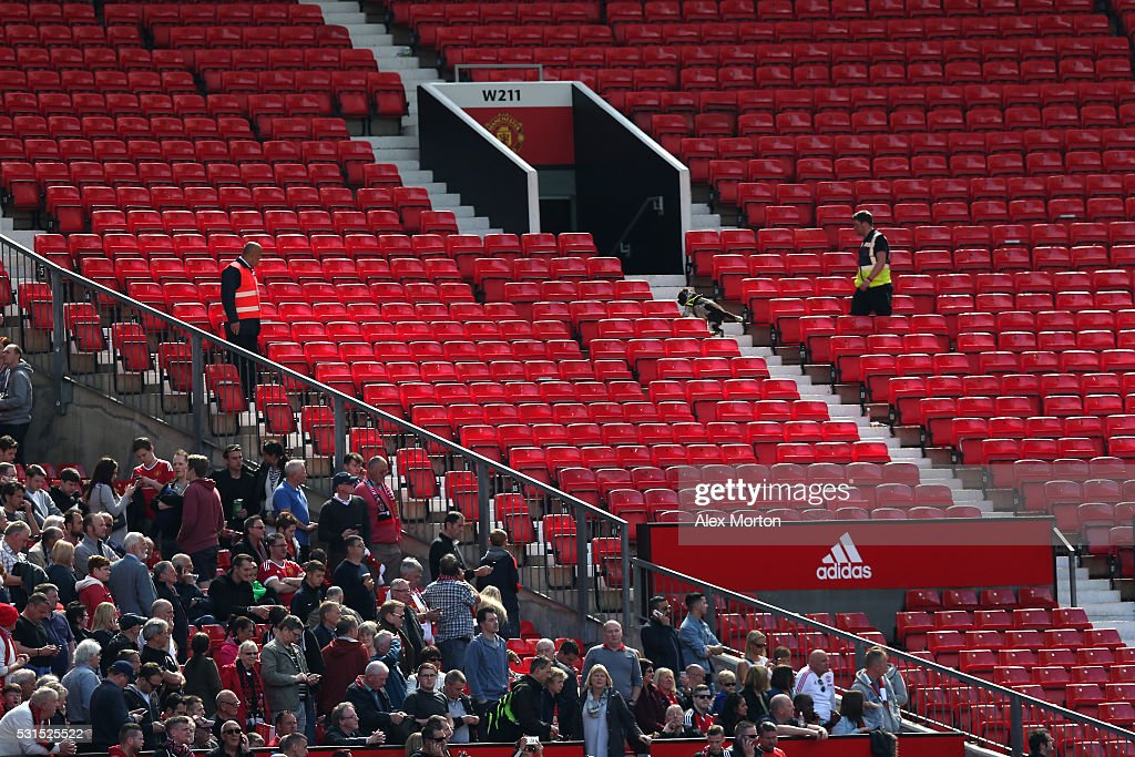 http://media.gettyimages.com/photos/sniffer-dog-patrols-the-stands-after-fans-were-evacuated-from-the-picture-id531525522