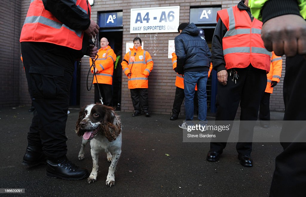 A Sniffer dog searching for flares and pyrotechnics outside the Hawthorns before the Barclays Premier League match between West Bromwich Albion and Crystal Palace at The Hawthorns on November 2, 2013 in West Bromwich, England.