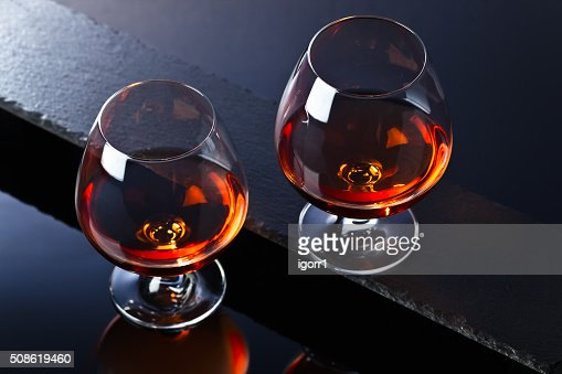 Snifter with brandy : Stock Photo