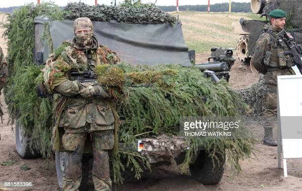 A sniper of the German armed forces Bundeswehr is pictured on May 10 2017 at the General Silvestras ukauskas Training Area in Pabrad Lithuania where...