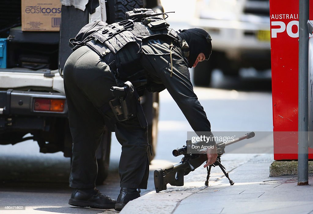 A sniper sets up on Philip Street at Martin Place on December 15 2014 in Sydney Australia Major landmarks in Sydney including the Sydeny Opera House...