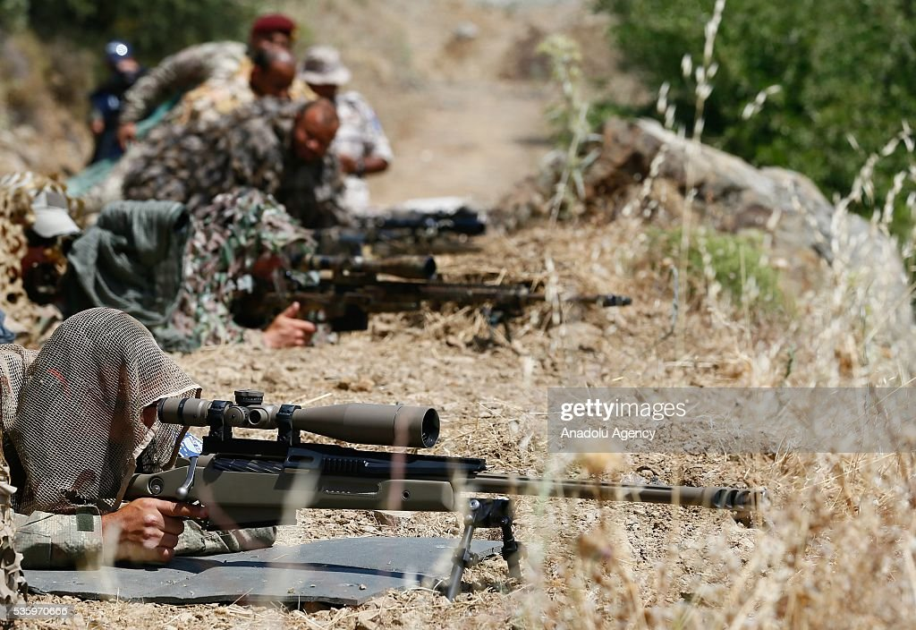 Snipers are in action during the Efes-2016 Combined Joint Live Fire Exercise at Seferihisar district of Izmir, Turkey on May 31, 2016. The Turkish-led multinational military exercises, Efes-2016 which started at 04 May and will be finished at 04 June 2016, aims to train participating units and staff in planning and conducting combined and joint operations, including logistics and command-control as well as to improve the level of interoperability among headquarters and forces.