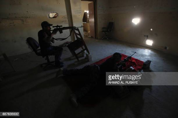 TOPSHOT Snipers from the Iraqi forces man their post at the frontline of the Old City of Mosul on March 25 during the government forces' ongoing...