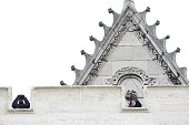 Snipers of the French police are pictured on the roof of a church in the northern Paris suburb of SaintDenis city center on November 18 to secure the...