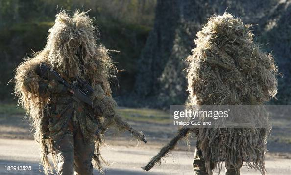 Snipers operate during the annual military exercises held for the media at the Bergen military training grounds on October 2 2013 near Munster...