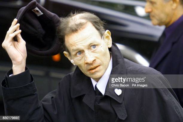 Snooker legend Alex Higgins arrives at St James Church in Malllow County Cork for the funeral of Oliver Reed Celebrity friends have flown in to...