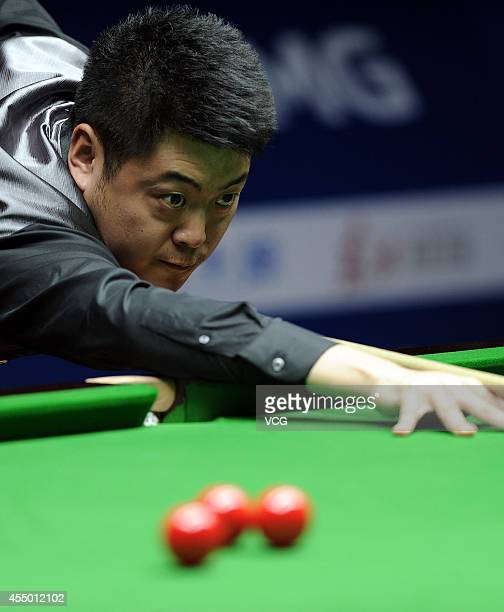 Snooker player Liang Wenbo of China hits a ball during qual round against snooker player Yan Bingtao of China at Bank of Communications 2014 World...