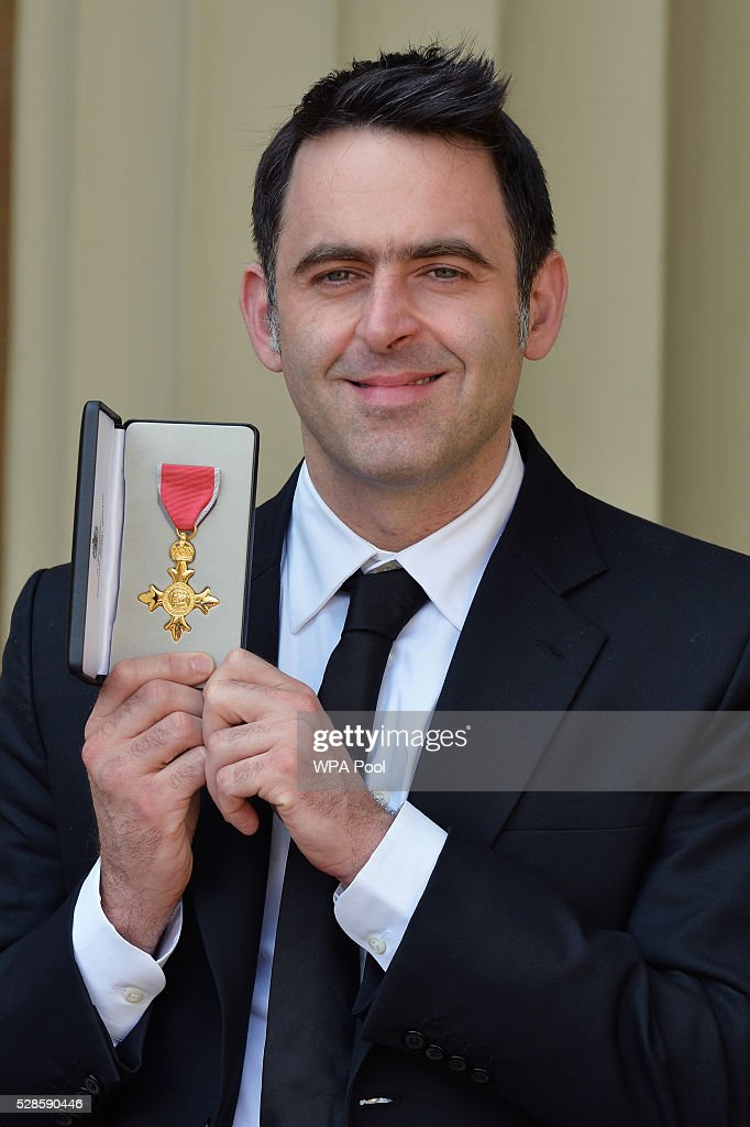 Snooker player <a gi-track='captionPersonalityLinkClicked' href=/galleries/search?phrase=Ronnie+O%27Sullivan&family=editorial&specificpeople=208991 ng-click='$event.stopPropagation()'>Ronnie O'Sullivan</a> poses with his partner Laila Rouass after receiving an OBE from the Prince of Wales at an investiture ceremony at Buckingham Palace on April 5, 2016 in London, United Kingdom.