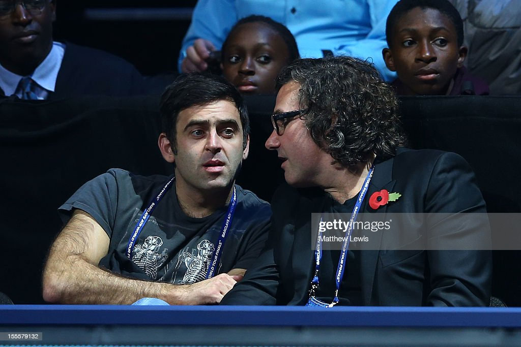 Snooker player Ronnie O'Sullivan (L) watches the action during the men's singles match between Novak Djokovic of Serbia and Jo-Wilfried Tsonga of France on day one of the ATP World Tour Finals at the O2 Arena on November 5, 2012 in London, England.