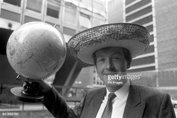 Snooker star Steve Davis holds up a globe and wears a sombrero during a promotional shoot for the world series which spans five continents Eight...