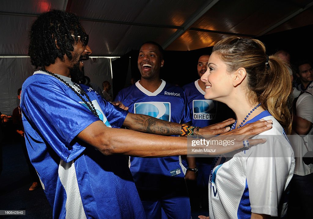 Snoop Dogg, AJ Calloway and Maria Menounos attend DIRECTV'S 7th annual celebrity Beach Bowl at DTV SuperFan Stadium at Mardi Gras World on February 2, 2013 in New Orleans, Louisiana.
