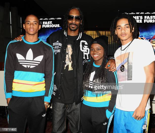 Snoop Dogg aka Snoop Lion and children Cordell Broadus Cori Broadus and Corde Broadus attend a screening of 'Turbo' at ArcLight Hollywood on July 16...