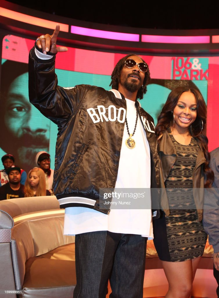 <a gi-track='captionPersonalityLinkClicked' href=/galleries/search?phrase=Snoop+Dogg&family=editorial&specificpeople=175943 ng-click='$event.stopPropagation()'>Snoop Dogg</a>, aka Snoop Lion, and host Kimberly 'Paigion' Walker visit at 106 & Park Studio on January 24, 2013 in New York City.